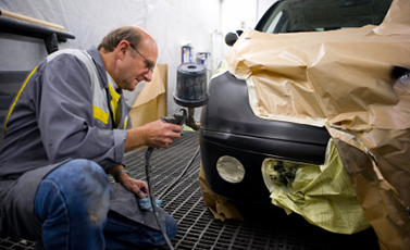 man buffing car